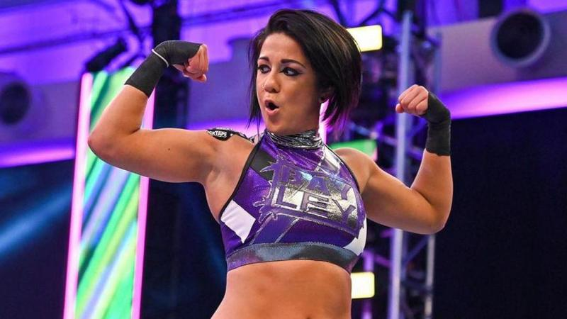 Why Bayley Shaved Michael Cole's Name On Her Head